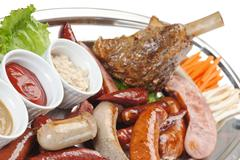dishes of roast meat with vegetables and spices - stock photo