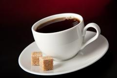 cup of coffee over black background - stock photo