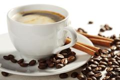 cup of coffee and roasted beans isolated - stock photo
