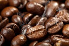 Hot roasted coffee beans background Stock Photos