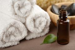 cosmetic bottle and towels - stock photo