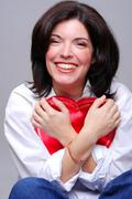 holding a heart shaped box of chocolates - stock photo