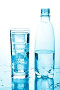Glass of water and bottle Stock Photos