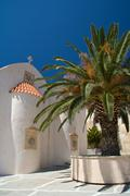 greek church and palm against blue sky - stock photo