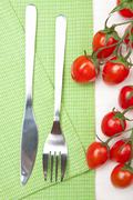 fork knife and tomatoes - stock photo