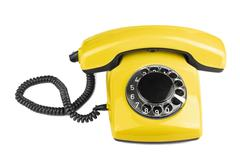 Stock Photo of old yellow phone isolated