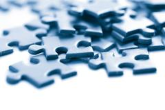 Blue puzzle pieces isolated Stock Photos