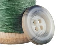 spool of thread and buttons - stock photo