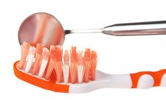 toothbrush and dental instruments - stock photo