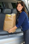 Loading groceries Stock Photos