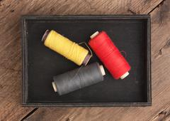 still life of spools of thread - stock photo