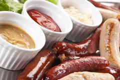 chopped sausages and spices - stock photo