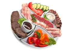 assorted sausages and vegetables - stock photo
