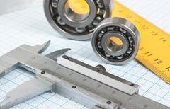 Setsquare and calliper with bearing Stock Photos