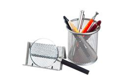 basket with pencils and pens on the book - stock photo