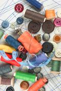 Various sewing accessories in the scheme Stock Photos