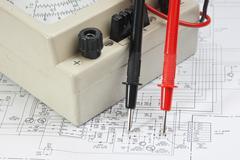 old multimeter on wiring diagram - stock photo