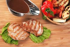 dishes of roast meat - stock photo