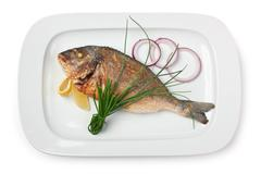 dish of fried fish with onions - stock photo