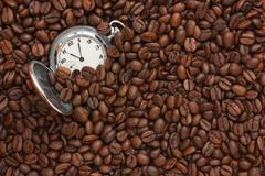 Stock Photo of pocket watch in coffee beans