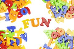 Fun lettering near plastic alphabet letters - stock photo