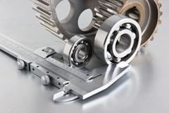 Gears and bearings with calipers Stock Photos