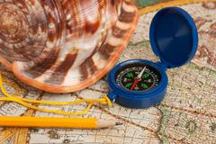 compass and seashell - stock photo