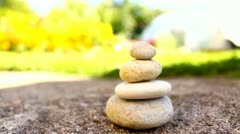 Stone tower, balance, pile of stones outdoors Stock Footage