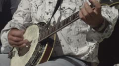 Slo-mo (true slow motion 240 FPS) banjo player close up Stock Footage