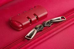 combination lock on a pink suitcase - stock photo