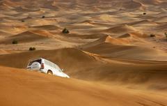 jeep safari in the sand dunes - stock photo