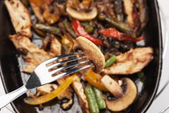 grilled meat with mushrooms and vegetables - stock photo