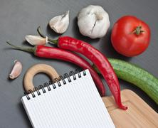 notebook for cooking recipes and vegetables - stock photo