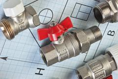 plumbing fittings on the drawing - stock photo