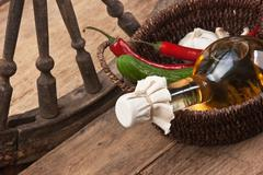 vegetables and  bottle of cooking oil in a basket - stock photo