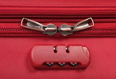 combination lock on a red suitcase - stock photo