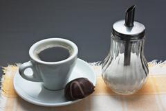 Stock Photo of cup of coffee and chocolate candy