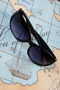 Stock Photo of sunglasses are on map