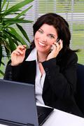 talking on a cellphone - stock photo