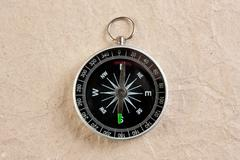 Stock Photo of compass on paper