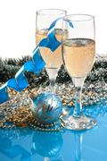 Two glasses of wine and christmas decoration Stock Photos