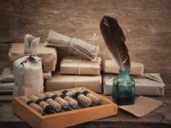 pile parcel and abacus - stock photo