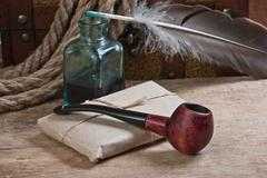 postal parcel, tobacco pipe and inkwell - stock photo