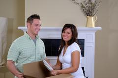 unpacking boxes at home - stock photo