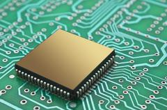 microchips on a printed circuit board - stock photo