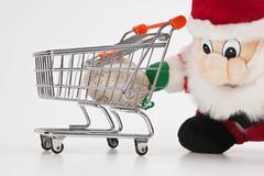 santa claus and shopping cart - stock photo