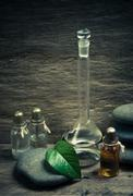 vials of perfume oils in fragrance lab - stock photo