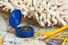 Stock Photo of compass and coral