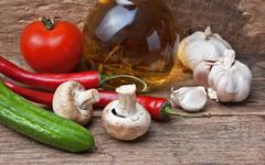 Glass bottle with spices and vegetables Stock Photos