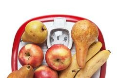 Fruit on the floor scales Stock Photos